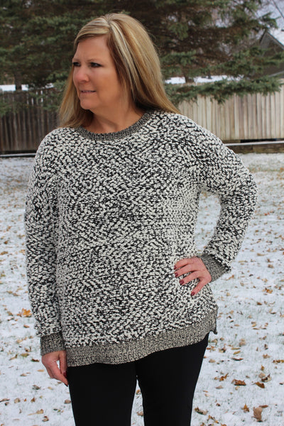 Cozy long sleeve black and white sweater, perfect for Fall and Winter.