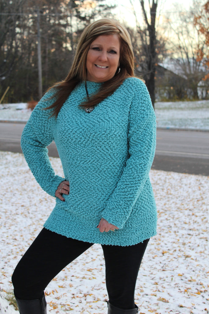 Cozy long sleeve sky blue sweater, perfect for Fall and Winter.