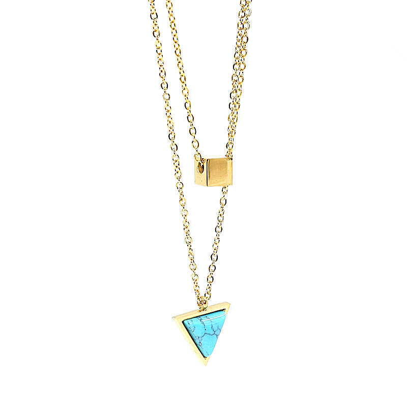 stacked necklace in gold with colourful pendant