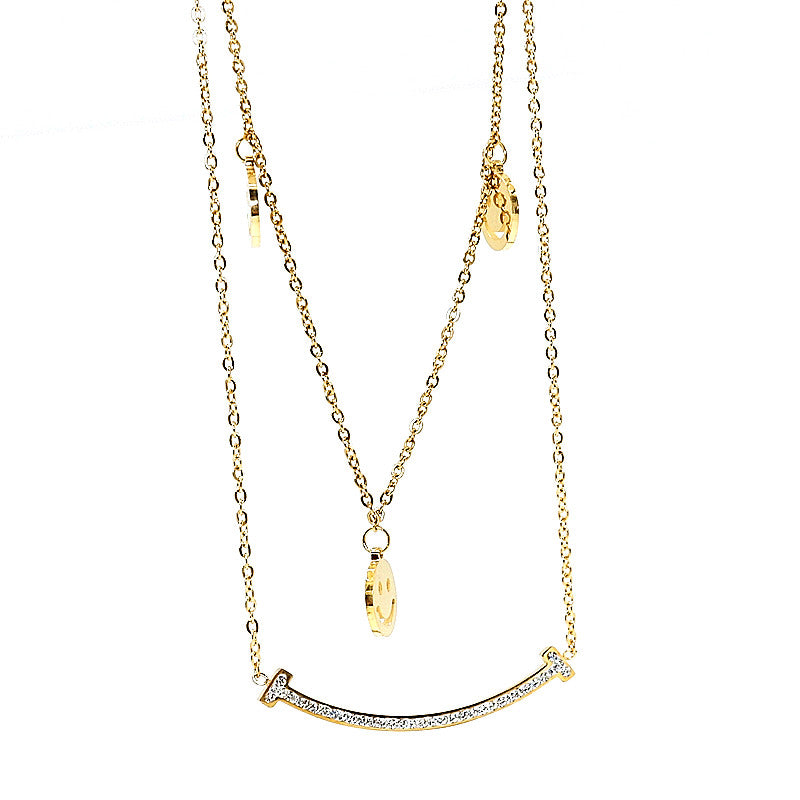 stacked necklace in gold with broad pendant