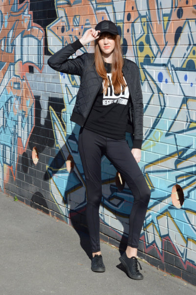 redhead-wearing-tall-active-wear-black-quilted-bomber-jacket-laneway-candid
