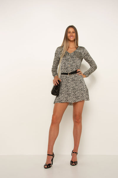long-black-and-white-leopard-work-dress-long-sleeve-silk-material-tall-girl-hand-on-hip