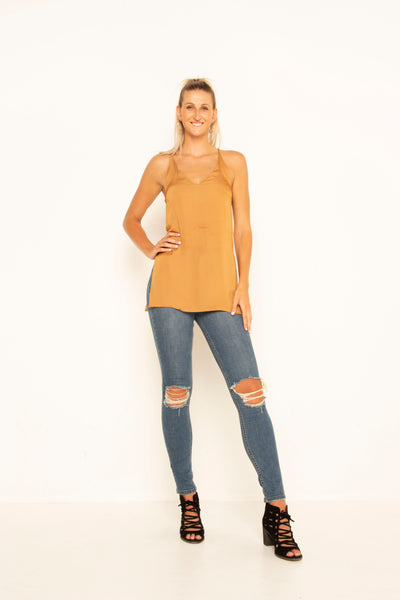tall-mustard-silky-top-front-hand-on-hip-v-neck-sleeveless-side-slits