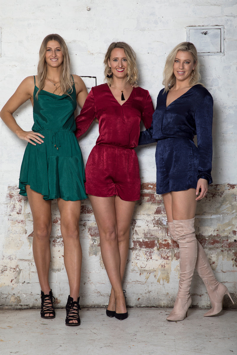 cross-over-long-sleeve-playsuit-front-hand-on-hip-evening-wear