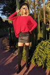 tall-girl-wearing-super-soft-boxy-knit-with-skirt-boots-and-hat-stylish-eveing-wear