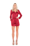 Raspberry-Cross-Over-Long-Sleeve-Playsuit-on-leggy-blonde-woman-full-body-front-view