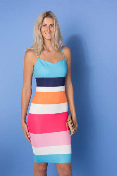 tall-blonde-woman-wearing-bright-bold-body-con-race-day-dress