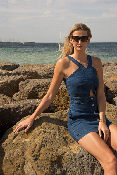 tall-blonde-wearing-denim-cut-out-dress-beach-waves