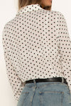 tall-girl-wearing-white-polka-dot-shirt-close-up-back-casual-look