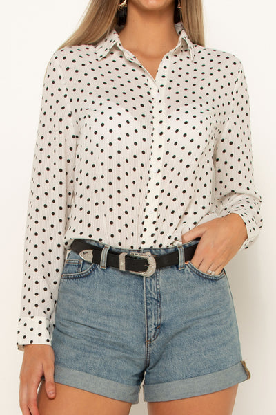 tall-girl-wearing-white-polka-dot-shirt-close-up-front-casual-look-button-up