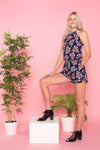 tall-leggy-blonde-wearing-tie-up-floral-romper-playsuit