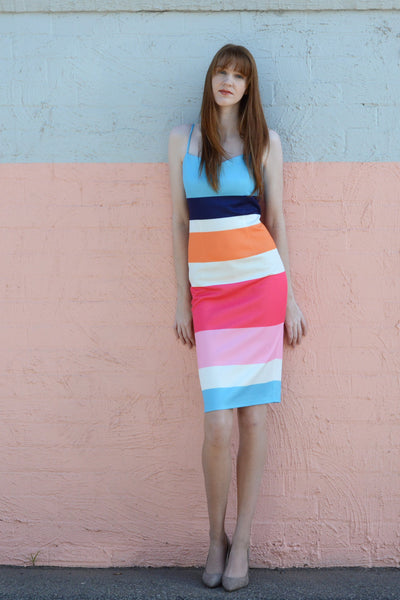 tall-redhead-wearing-race-day-bold-multi-strap-body-con-dress-pastel-wall
