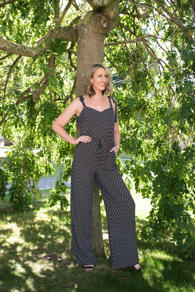 tall-girl-wearing-tie-shoulder-jumpsuit-in-nature-long-torso-flattering-fit