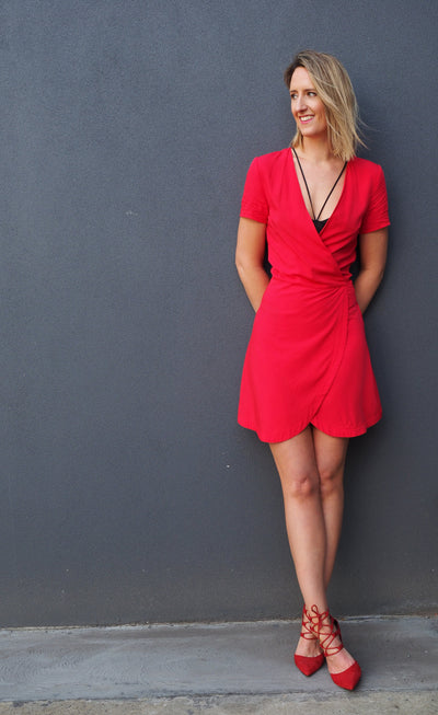 tall-blonde-wearing-racy-red-wrap-dress-full-front-view-candid