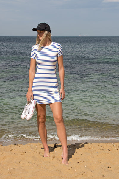 nautical-strip-tshirt-dress-paired-with-cap-beach-holiday