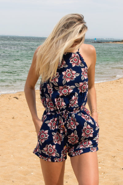 casual-tie-up-navy-romper-playsuit-with-floral-print-worn-by-tall-blonde
