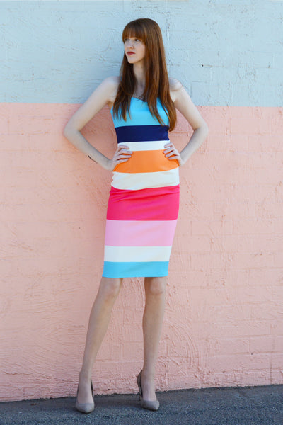 bright-multi-strap-body-con-dress-worn-by-tall-redhead