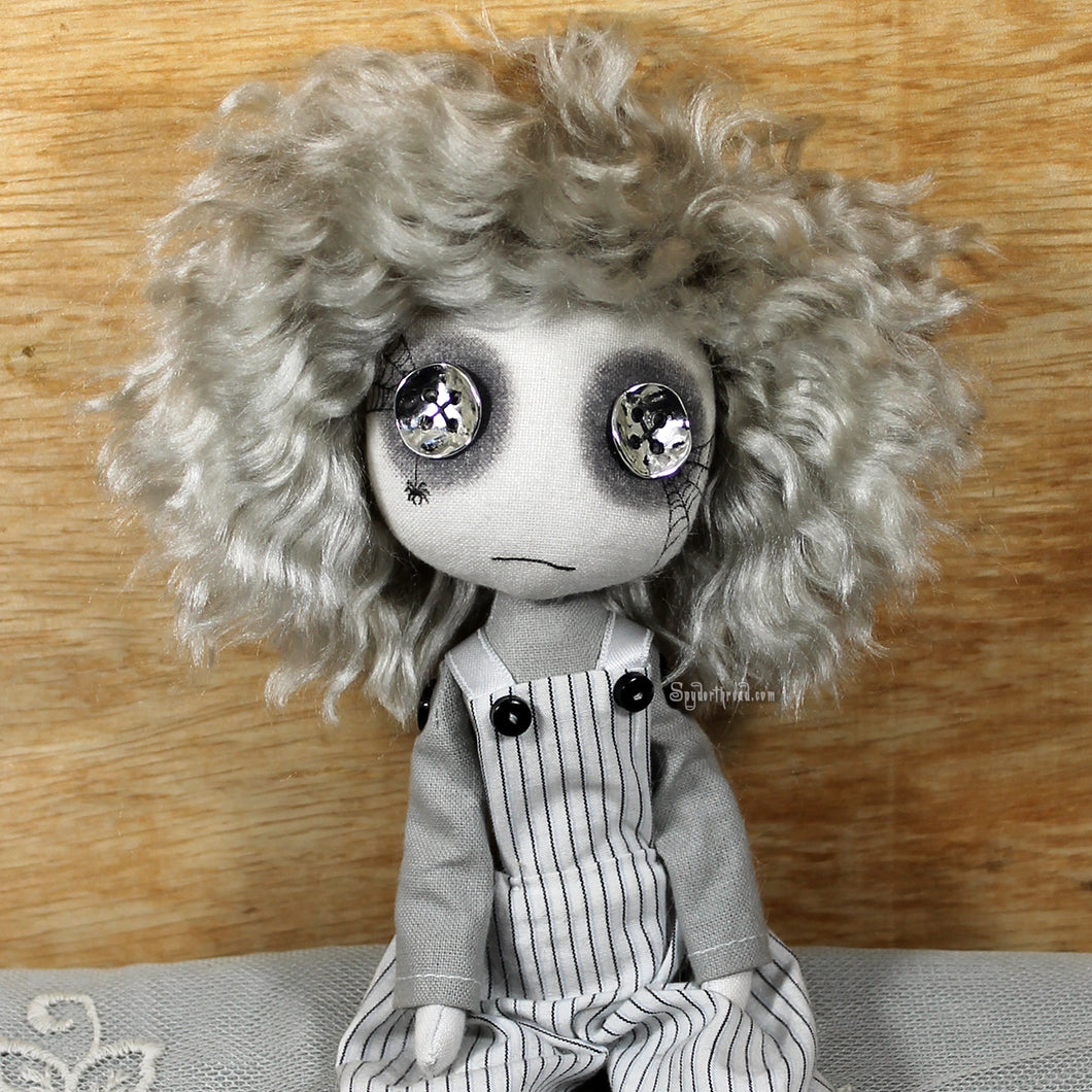 A button eyed ghost boy doll with silver hair and white dungarees - Christopher Darkhouse by textile artist Jo Hards of Spyderthread