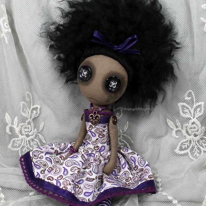 OOAK BAME cloth art doll, in a purple paisley cotton dress, with satin ribbon and a copper heart necklace