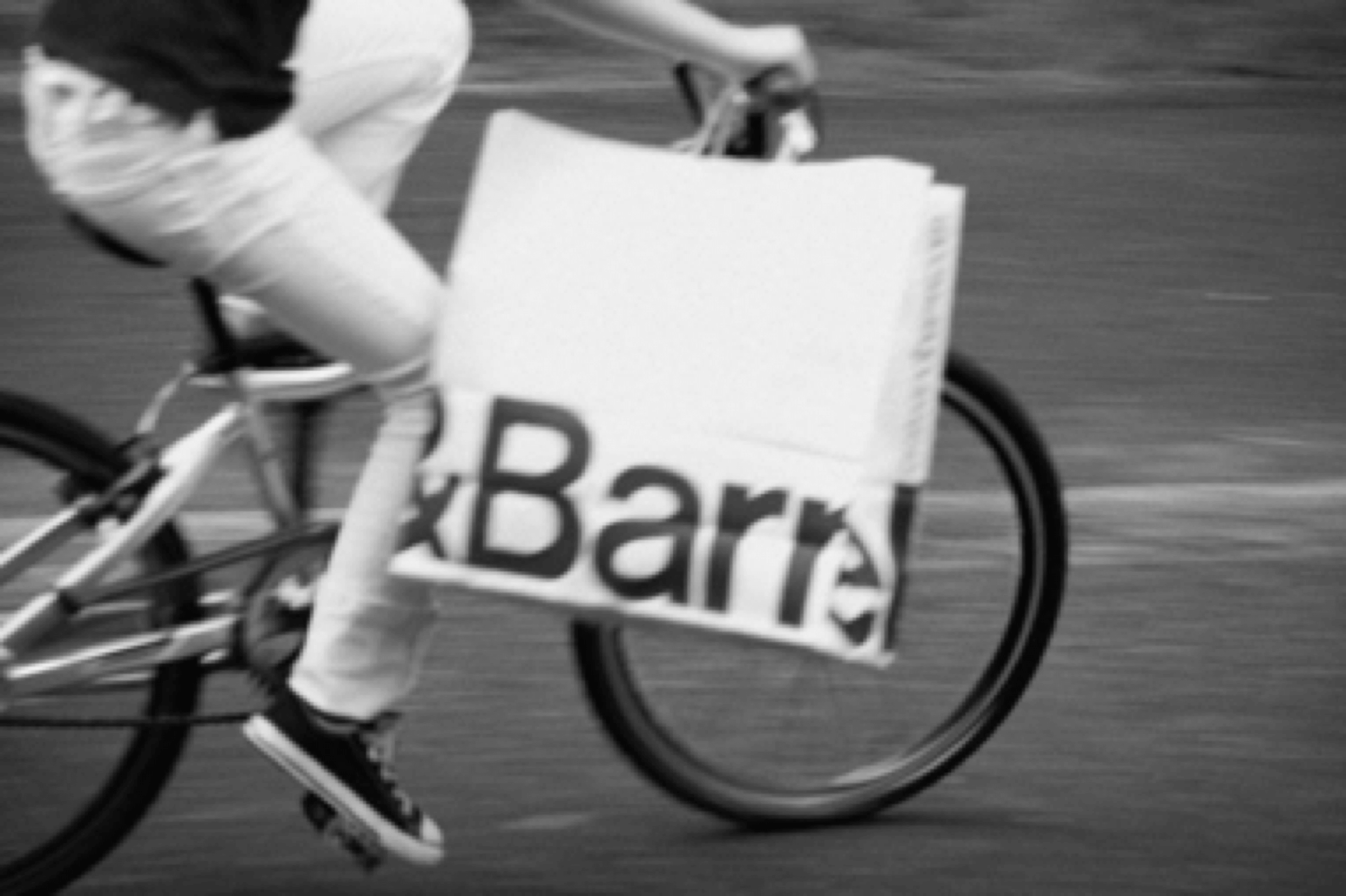 Crate + Barrel advertisement of woman on a bike styled by Sarah Parlow Fashion Stylist