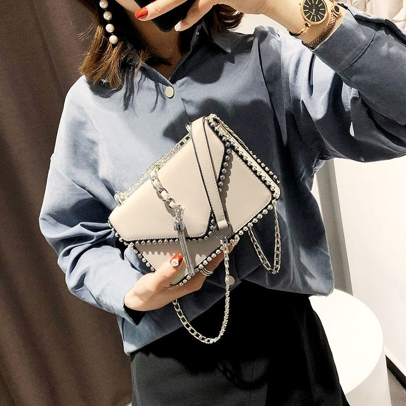 British Fashion Simple Small Square bag Women's Designer Handbag 2018 High-quality PU leather Rivet Tassel Chain Shoulder bags