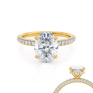 Lily Arkwright Oval Cut Moissanite 18k Yellow Gold Petite Hidden Halo Triple Pavé Shoulder Set