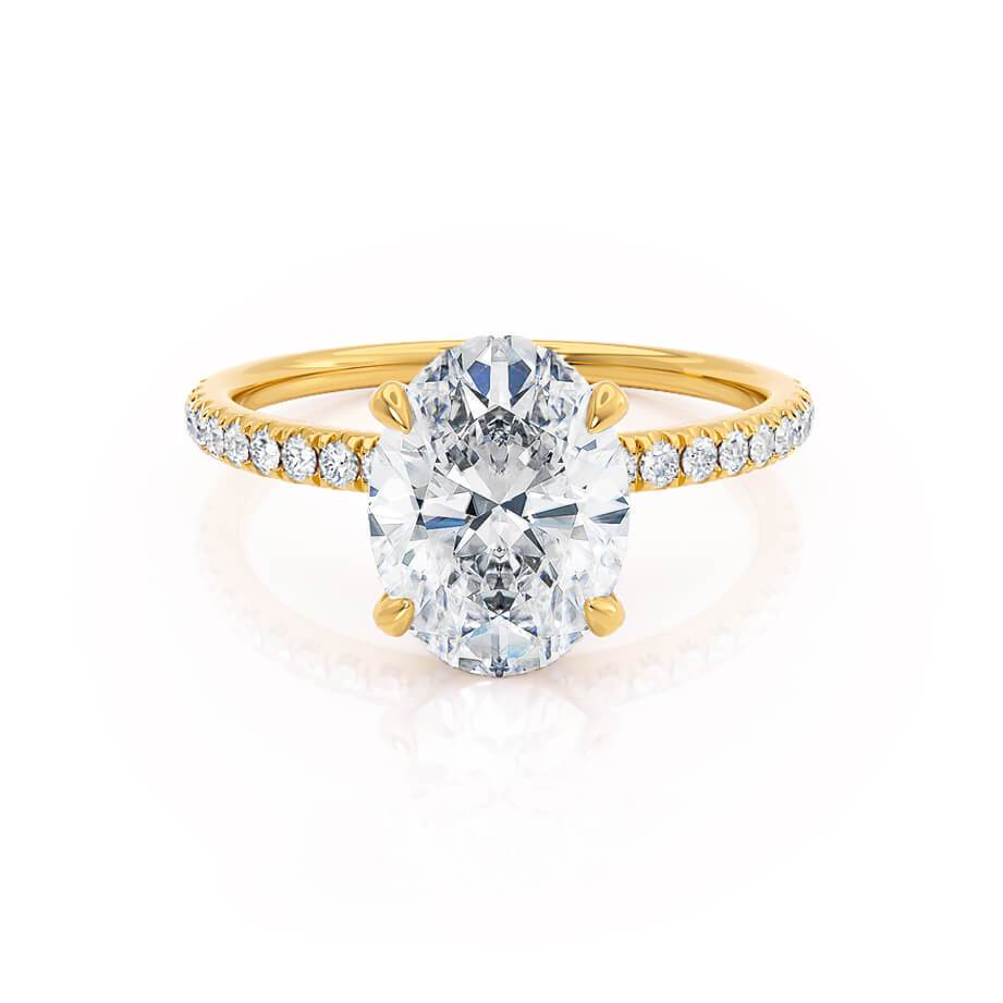 Oval cut moissanite hidden halo 18k yellow gold engagement ring Lily Arkwright
