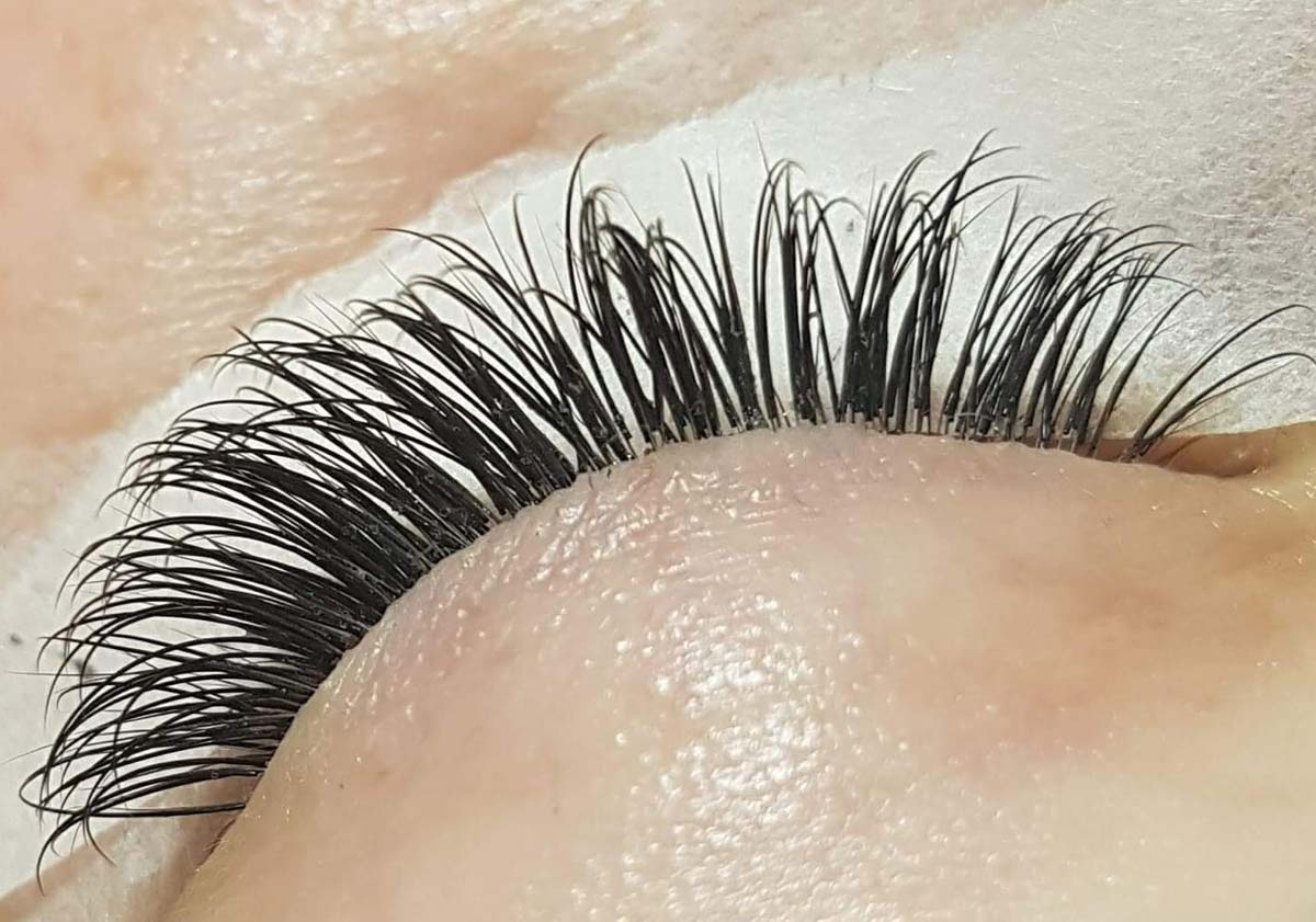 Eyelash extensions. Patch test required.