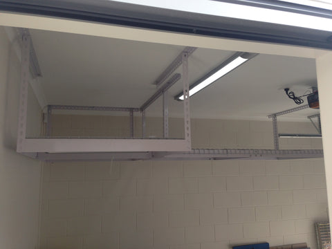 Two ceiling storage racks installed
