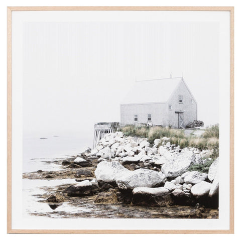 Square framed photographic landscape of a serene coastal scene in Norway with a Boathouse
