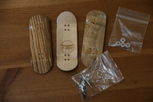 Hand crafted exotic wood finger skateboards