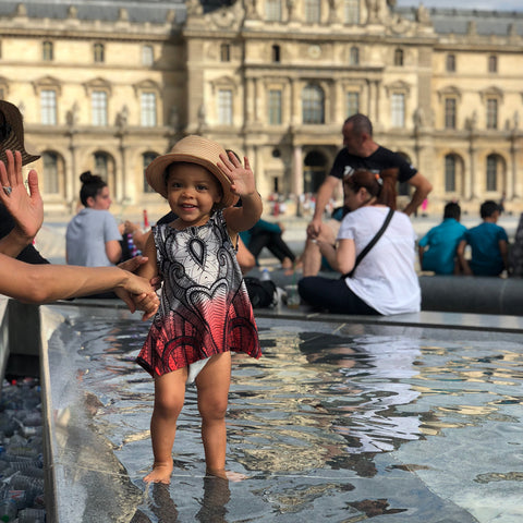 Toddler in Paris, Nyaeli waves goodbye to Musee du Louvre, enjoying the cool water fountain after a long walk through the museum, ShoptheKei.com