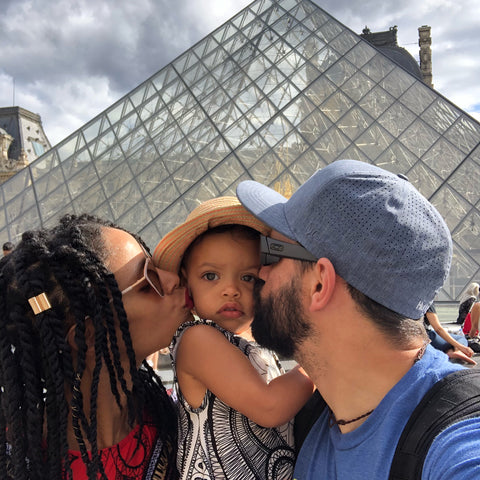 family trip to Louvre in Paris, France. My daughter, mommy and daddy kisses. ShoptheKei.com