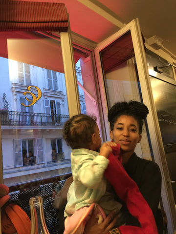 a toddler in Paris, being a hand full with her aunt at Cafe Constant. ShoptheKei.com
