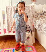 La-di-da-di she loves to party! In her fly Flayva jumpsuit and sneakers, your girl sports a fresh look like no other. Believe me, she'll show off those gold studs at the next play date. Make her memories in style ShoptheKei.com
