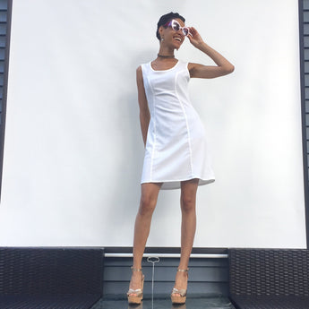 You are incredibly stylish in our refreshing white sundress! Heat up the party. Olivia flare dress is perfect dress for summer outings. ShoptheKei.com