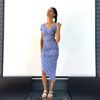 Sway gently along the coast of turquoise seas in your pretty blue Rain dress. Gorgeous beach cocktail dress for summer. ShoptheKei.com
