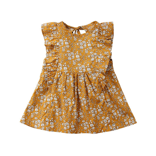 Baby found her happy place on a park bench with her collection of colorful fall leaves. Giggle in vintage inspired, floral Abigail Baby Dress for your mini! ShoptheKei.com