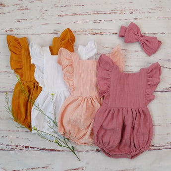 She will amaze you in her Lyla Baby Romper! Teach baby's wobbly little legs to crawl in her stylish ruffled baby bodysuit. ShoptheKei.com