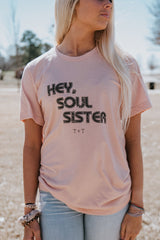 A blush tee is a wardrobe staple in our eyes. This color makes the black ink and her beautiful tan pop!
