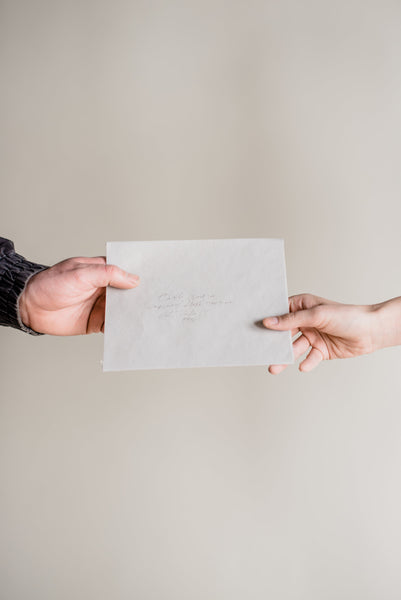 DISTANCE || Hand holding a letter - BORCIK