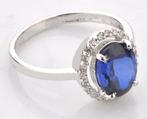 18KT SOLID GOLD OVAL SHAPE 2.55 CARATS NATURAL BLUE TANZANITE & EGL CERTIFIED DIAMOND RING