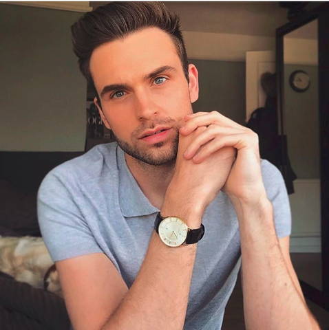image of instagram influencer James Aspley wearing a Charles Conrad black leather watch