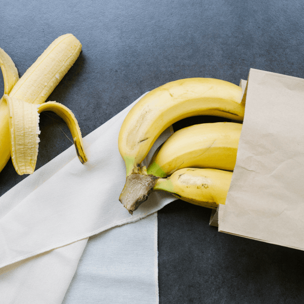Bananas in a paper bag on a napkin