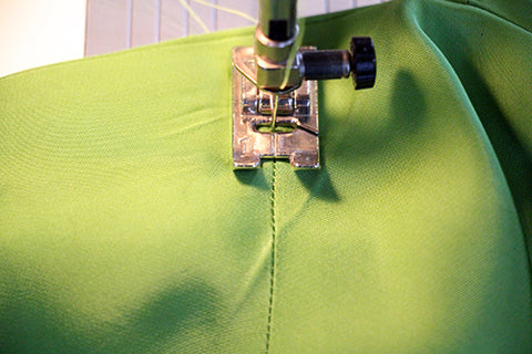 Stitch in the ditch to secure the facing at the shoulder seam