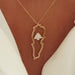 18k gold map of Lebanon with cedar tree necklace