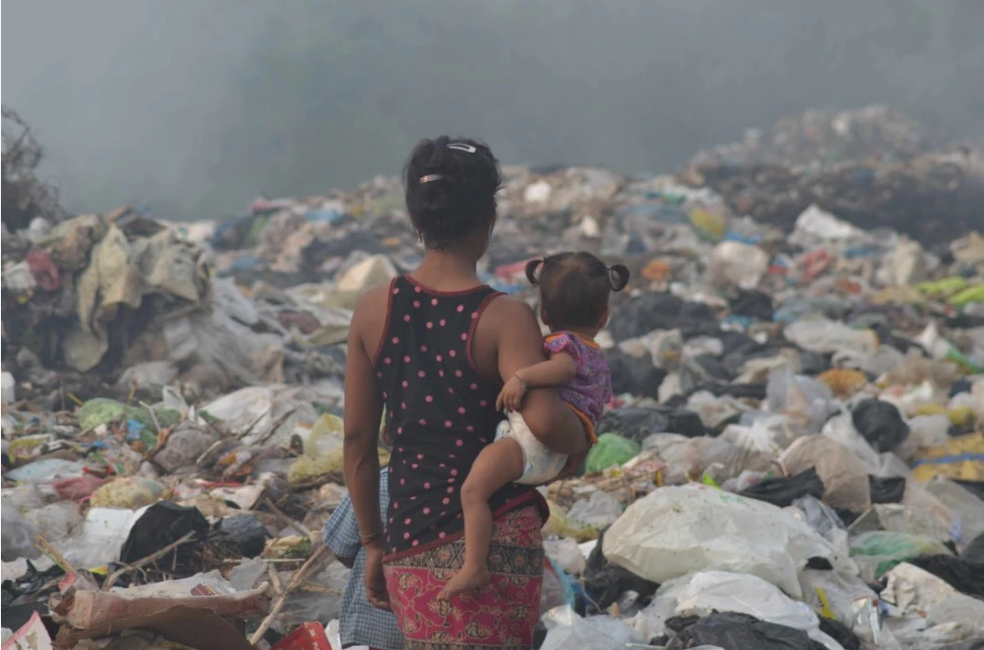 Mum and baby on a rubbish dump