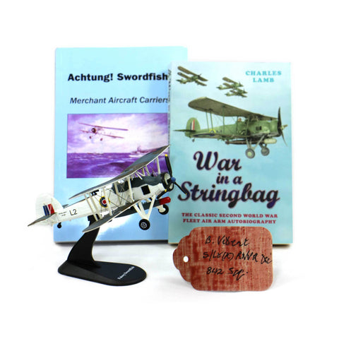 Two books (Achtung Swordfish and War in a Stringbag) Die cast model Swordfish and  a canvas swatch from a Swordfish signed by the late Bruce Vibert who flew Swordfish