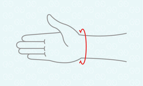 Roll a paper strip around the wrist and mark the overlapping point with a ball pen.