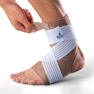 Dual layered ankle support and pain relief orthotic aid by Oppo Medical. Base made of perforated neoprene with cotton lining and additional elastic strap of nylon and rubber fibers. Product Code 1003